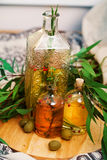 Olive oil with rosemary and spices leaves, green Stock Images