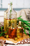 Olive oil with rosemary and spices leaves, green Royalty Free Stock Photography