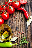 Olive Oil,Rosemary, Tomatoes and Peppercorns Frame Stock Image