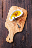 Olive oil with saffron Stock Photography