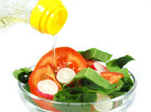 Olive oil and salad Royalty Free Stock Image