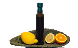 Olive oil and sicilian fruits. Isolated on white Royalty Free Stock Image
