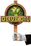 Olive Oil - Sign with Hand of Chef Stock Images