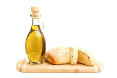 Olive oil and sliced bread on cutting board Royalty Free Stock Image