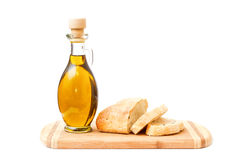 Olive oil and sliced bread on cutting board Stock Photos
