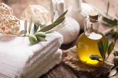 Olive oil soap and bath towel. On wooden table royalty free stock image