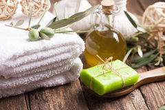 Olive oil soap and bath towel Royalty Free Stock Photo