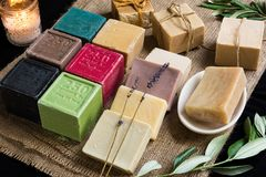 Olive oil soaps. Various colored olive oil soaps on sackcloth royalty free stock images