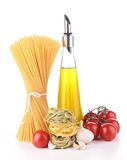Olive oil with spaghetti and tomato Royalty Free Stock Images