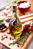Olive oil with spices Royalty Free Stock Photos