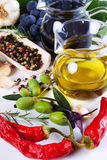 Olive oil with spices and food ingredients Royalty Free Stock Image