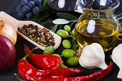 Olive oil with spices and food ingredients Stock Image