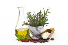 Olive oil, spices and herbs Royalty Free Stock Photography