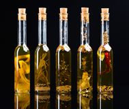 Olive oil with spices and herbs. Royalty Free Stock Image