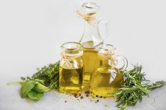 Olive oil with spices and herbs Royalty Free Stock Photos