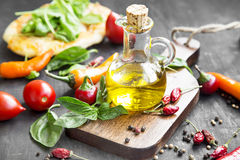 Olive Oil with Spices and Herbs on Wooden Board Royalty Free Stock Photo