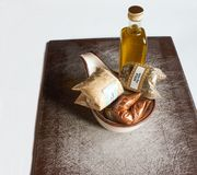 Olive oil, spices and sauce boat Stock Images
