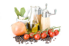 Olive oil, spices and vegetables Royalty Free Stock Images