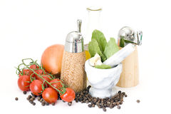 Olive oil and spices and vegetables Royalty Free Stock Photo