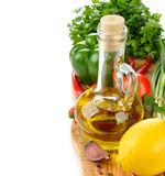 Olive oil, spices and vegetables Royalty Free Stock Photo