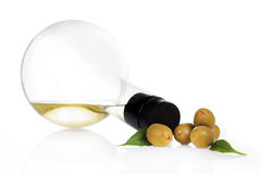 Olive oil and  spoon Stock Image