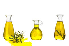 Olive oil three glass bottles isolated Stock Images