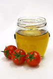 Olive oil with tomato. Olive oil with cherry tomatoes Royalty Free Stock Photos