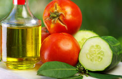 Olive oil, tomato, cucumber stock images