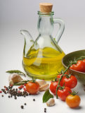 Olive oil and tomatoes Stock Images