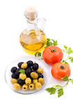 Olive oil, tomatoes and greens Stock Images