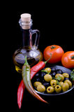 Olive oil, tomatoes, pepper and greens Stock Images