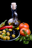 Olive oil, tomatoes, pepper and greens Royalty Free Stock Photos