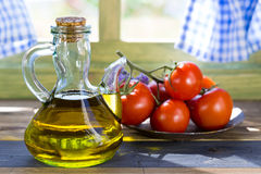 Olive oil and tomatoes Royalty Free Stock Photo