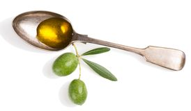 Olive oil and twig with olives. Stock Photography
