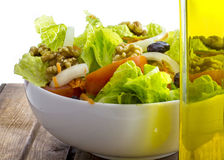 Olive oil and vegetable salad Stock Images