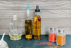 Olive oil, vegetable oil and spices for cooking. Dishes for your table Stock Photo