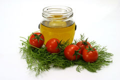 Olive oil and vegetables. Olive oil with cherry tomatoes and fennel Stock Photos