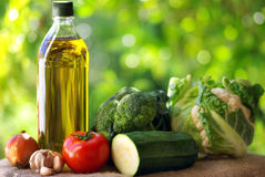 Olive oil and vegetables. Royalty Free Stock Image