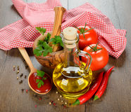 Olive oil, vegetables and spices Royalty Free Stock Image