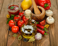 Olive oil, vegetables and spices Stock Photos