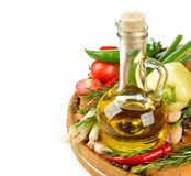 Olive oil, vegetables and spices Royalty Free Stock Photo