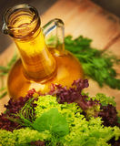 Olive oil and vegetarian salad Stock Image