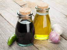 Olive oil and vinegar bottles with spices Stock Images