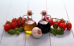 Olive oil and vinegar in bottles on wooden table Royalty Free Stock Photo