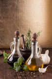 Olive oil and vinegar with herbs Royalty Free Stock Photo