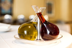 Olive oil and vinegar. Still life with olive oil and vinegar on a table stock photography