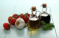 Olive oil and vinegar in vintage bottles on wooden table Stock Photo