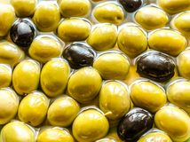 Olive oil and whole olives Royalty Free Stock Image