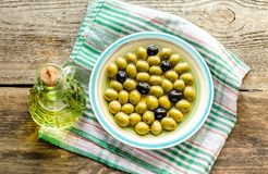 Olive oil and whole olives Stock Photo
