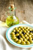 Olive oil and whole olives Stock Photography